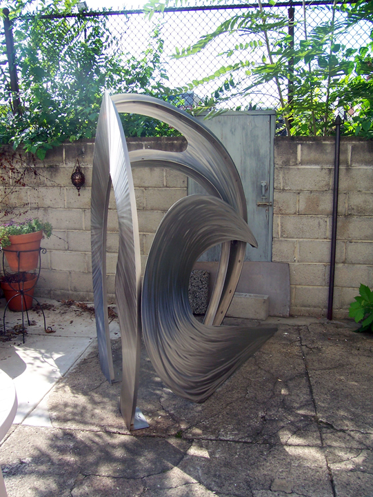 abstract, contemporary, free standing, stainless steel sculpture